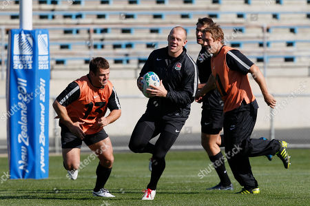 Lee Mears, Jonny Wilkinson, Mike Tindall England rugby players Lee Mears, left, Jonny Wilkinson chase Mike Tindall, centre, with the ball and as they take part in a training session in Dunedin, New Zealand, Tuesday, Sept., 20, 2011. England will play Romania in their next Rugby World Cup match in Dunedin Saturday, Sept. 24