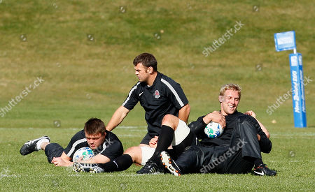England rugby players from the left David Wilson, Lee Mears, Lewis Moody and hidden on ground Simon Shaw during a training session in Queenstown, New Zealand, Wednesday, Sept., 14, 2011. England play their next Rugby World Cup game against Georgia on Sept. 18
