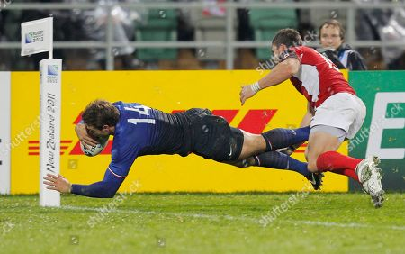 Stock Picture of France's Vincent Clerc scores a try in the corner as Canada's James Pritchard attempts a tackle during their Rugby World Cup game at McLean Park, in Napier, New Zealand