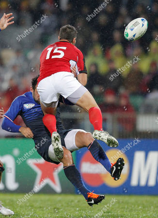 Canada's James Pritchard, right, and France's David Marty compete to catch the ball during their Rugby World Cup game at McLean Park, in Napier, New Zealand