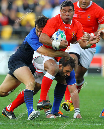 Tonga's Siale Piutau is tackled by France's Fabrice Estebanez, left, during their Rugby World Cup game in Wellington, New Zealand