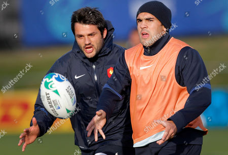 Fabrice Estebanez, David Marty French rugby players Fabrice Estebanez, left, and David Marty catch the ball during a training session, in Auckland, New Zealand, . France will play New Zealand All Blacks in their next Rugby World Cup match on Saturday, Sept. 24 in Auckland