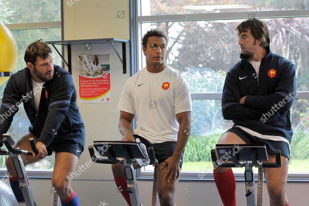 French rugby players from left, Lionel Nallet, Thierry Dusautoir, and Julien Pierre warm up during a training session, in Auckland, New Zealand, . France will play the New Zealand All Blacks in their next Rugby World Cup match on Saturday, Sept. 24 in Auckland