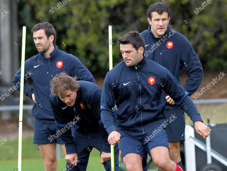 French rugby players, from left, Morgan Parra, Cedric Heymans, Fabrice Estebanez, and Damien Traille practise during a training session, in Auckland, New Zealand, . France will play the New Zealand All Blacks in their next Rugby World Cup match on Saturday, Sept. 24 in Auckland