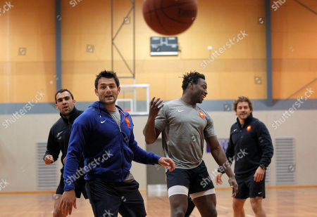 French rugby players from left, David Marty, Fabrice Estebanez, Fulgence Ouedraogo, and Cedric Heymans play basketball during a training session, in Auckland, New Zealand, . France will play Tonga in their next Rugby World Cup match on Saturday, Oct. 1 in Wellington