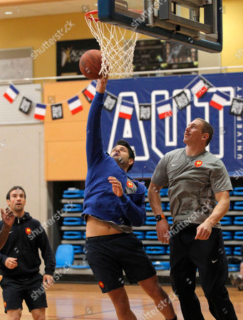 French rugby players Fabrice Estebanez, center, Imanol Harinordoquy, right, and Morgan Parra play basketball during a training session, in Auckland, New Zealand, . France will play Tonga in their next Rugby World Cup match on Saturday, Oct. 1 in Wellington