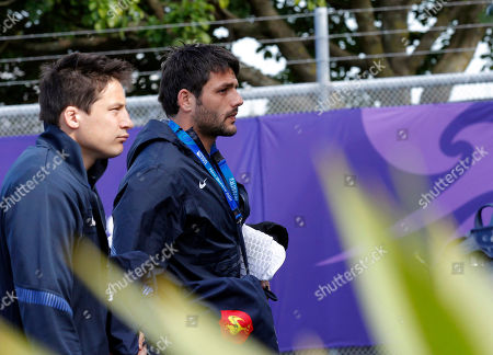 French rugby players Francois Trinh-Duc, left, and Fabrice Estebanez arrive for a training session in Auckland, New Zealand, . France will play England in their quarterfinal Rugby World Cup match at Eden Park, on Saturday Oct. 8
