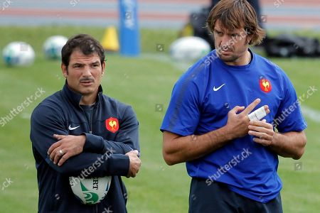 French rugby players Julien Pierre, right, looks at coach Marc Lievremont, during a training session in Auckland, New Zealand, . France will play England in their quarterfinal Rugby World Cup match at Eden Park on Saturday, Oct. 8