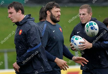 French rugby players Louis Picamoles, left, Lionel Nallet, center, and Imanol Harinordoquy take part in a training session in Auckland, New Zealand, . France will play Wales in their Rugby World Cup semifinal match on Saturday, Oct. 15