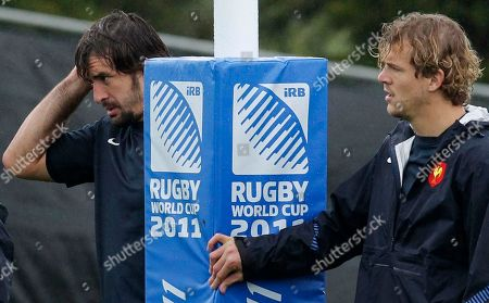French rugby players Julien Pierre, left, and Aurelien Rougerie listen to the coach during a training session in Auckland, New Zealand, .France will play Wales in their Rugby World Cup semifinal match on Saturday, Oct. 15