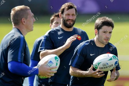 French rugby players Dimitri Yachvili, right, Lionel Nallet, center, and Imanol Harinordoquy run during a training session in Auckland, New Zealand, . France will play the New Zealand All Blacks in the final of the Rugby World Cup on Sunday, Oct. 23