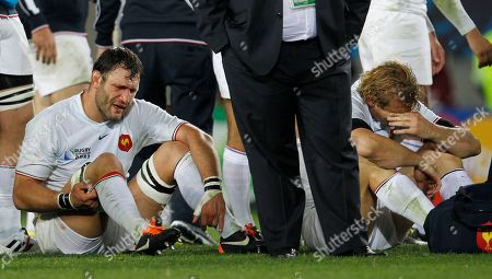 France's Lionel Nallet and Aurelien Rougerie, right, react after their Rugby World Cup final loss to the New Zealand All Blacks at Eden Park in Auckland, New Zealand