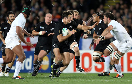 Richard Kahui New Zealand All Blacks Richard Kahui attempts to run between France's Thierry Dusautoir, left, and Lionel Nallet during their Rugby World Cup final at Eden Park in Auckland, New Zealand