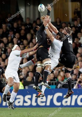 Jerome Kaino, Brad Thorn New Zealand All Blacks Jerome Kaino, second from left, and Brad Thorn, right, compete to catch the ball against France's Lionel Nallet during their Rugby World Cup final at Eden Park in Auckland, New Zealand