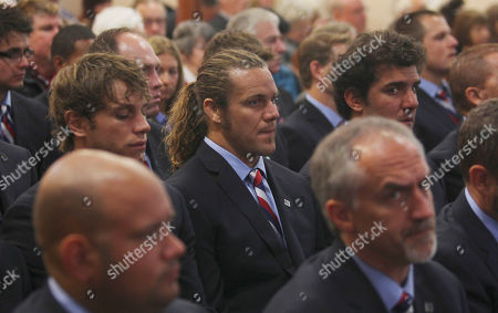 Captain of U.S. rugby team Todd Clever, center, stands with his teammates during a special service to commemorate the 10th anniversary of the Sept. 11 terrorist attacks, at a church in New Plymouth, New Zealand, . The US team will play Ireland in their opening Rugby World Cup game later today