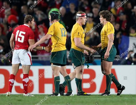 Leigh Halfpenny, Berrick Barnes, David Pocock, Luke Burgess Wales' Leigh Halfpenny, left, shakes hands with Australia's Berrick Barnes, as Australia's David Pocock, second right, shakes hand with teammate Luke Burgess during their bronze medal Rugby World Cup game at Eden Park in Auckland, New Zealand