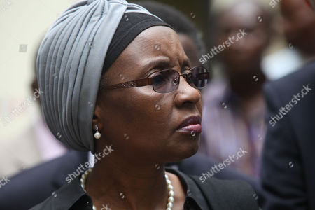 """United Nations Deputy Secretary-General Dr. Asha-Rose Migiro arrives to inspect the damage of the bombed United Nations office after a car bombing on Friday in Abuja, Nigeria which killed at least 19 people. Nigeria's president says his government will bring terrorism """"under control"""