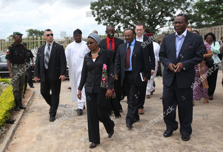 """United Nations Deputy Secretary-General Dr. Asha-Rose Migiro, center, arrives to inspect the damage of the bombed United Nation's office after a car bombing on Friday in Abuja, Nigeria which killed at least 19 people. Nigeria's president says his government will bring terrorism """"under control"""
