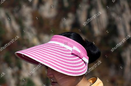 A woman wears a sun hat as she and fellow North Korean hikers climb Mount Kumgang, North Korea. It's hard to imagine a North Korea without Kim Jong Il, who led the nation for 17 years until his death on Dec. 17. His death marks the end of an era for North Korea, which has known only two leaders: Kim and his father, Kim Il Sung. Already, a new era has begun under the leadership of his young son, Kim Jong Un. Still, Kim Jong Il's presence is felt in every frame of a series of images made by Associated Press photographer David Guttenfelder. During the last months of Kim's life, Guttenfelder, along with AP Korea Bureau Chief Jean H. Lee, made several trips to North Korea