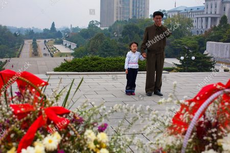 A North Korean man weeps and holds a hand of a young girl as they stand before a statue of the late North Korean leader Kim Il Sung on the 66th anniversary of the communist nation's ruling Workers' Party in Pyongyang. It's hard to imagine a North Korea without Kim Jong Il, who led the nation for 17 years until his death on Dec. 17. His death marks the end of an era for North Korea, which has known only two leaders: Kim and his father, Kim Il Sung. Already, a new era has begun under the leadership of his young son, Kim Jong Un. Still, Kim Jong Il's presence is felt in every frame of a series of images made by Associated Press photographer David Guttenfelder. During the last months of Kim's life, Guttenfelder, along with AP Korea Bureau Chief Jean H. Lee, made several trips to North Korea