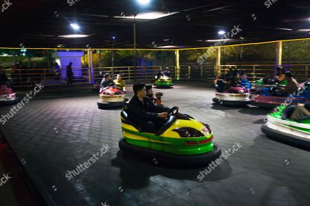 A North Korean woman uses a personal video camera as she and others enjoy the bumper car ride at an amusement park in Pyongyang. It's hard to imagine a North Korea without Kim Jong Il, who led the nation for 17 years until his death on Dec. 17. His death marks the end of an era for North Korea, which has known only two leaders: Kim and his father, Kim Il Sung. Already, a new era has begun under the leadership of his young son, Kim Jong Un. Still, Kim Jong Il's presence is felt in every frame of a series of images made by Associated Press photographer David Guttenfelder. During the last months of Kim's life, Guttenfelder, along with AP Korea Bureau Chief Jean H. Lee, made several trips to North Korea