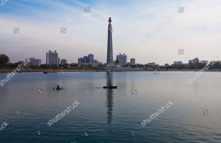 North Koreans enjoy a row boat outing on the Taedong River as one passes through the reflection of the Tower of the Juche Idea in Pyongyang. It's hard to imagine a North Korea without Kim Jong Il, who led the nation for 17 years until his death on Dec. 17. His death marks the end of an era for North Korea, which has known only two leaders: Kim and his father, Kim Il Sung. Already, a new era has begun under the leadership of his young son, Kim Jong Un. Still, Kim Jong Il's presence is felt in every frame of a series of images made by Associated Press photographer David Guttenfelder. During the last months of Kim's life, Guttenfelder, along with AP Korea Bureau Chief Jean H. Lee, made several trips to North Korea