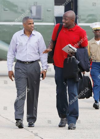 Stock Photo of Martin Nesbitt, Reggie Love Marty Nesbitt and Reggie Love accompany President Barack Obama at Andrews Air Force Base, Md., as he travels to Paterson, N.J. to view flood damage caused by Hurricane Irene