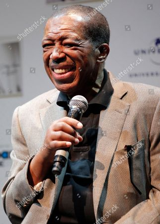 "Singer Ben E. King smiles during a news conference in Tokyo. King, singer of such classics as ""Stand By Me,"" ""There Goes My Baby"" and ""Spanish Harlem,"" died, publicist Phil Brown told The Associated Press. He was 76"