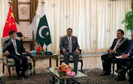 """Stock Picture of Chinese Public Security Minister Meng Jianzhu, left, meets Pakistan's Prime Minister Yusuf Raza Gilani in Islamabad, Pakistan on . China's top security official is visiting Pakistan for talks focusing on increased cooperation against Chinese militants who have found sanctuary in the northwest of the country. Pakistan's interior minister Rehman Mali, right, has vowed to """"strike very hard"""" Chinese militants hiding out in his country's tribal regions"""