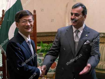 Chinese Public Security Minister Meng Jianzhu, left, shakes hands with Pakistan's Prime Minister Yusuf Raza Gilani in Islamabad, Pakistan on . China's top security official is visiting Pakistan for talks focusing on increased cooperation against Chinese militants who have found sanctuary in the northwest of the country