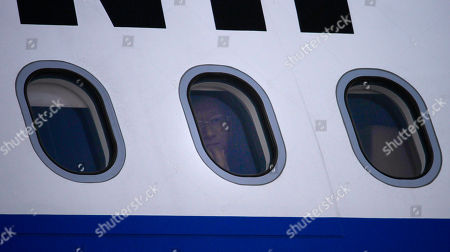 Chinese Public Security Minister Meng Jianzhu peers through window of a plane upon his arrival at Chaklala airbase in Rawalpindi, Pakistan on . China's top security official is visiting Pakistan for talks focusing on increased cooperation against Chinese militants who have found sanctuary in the northwest of the country