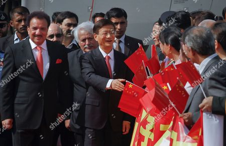 Chinese Public Security Minister Meng Jianzhu, center, shake hands with Chinese diplomats as Pakistani Interior Minister Rehman Malik, left, looks on at Chaklala airbase in Rawalpindi, Pakistan on . China's top security official is visiting Pakistan for talks focusing on increased cooperation against Chinese militants who have found sanctuary in the northwest of the country