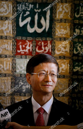 Chinese Public Security Minister Meng Jianzhu talks to reporters upon his arrival at Chaklala airbase in Rawalpindi, Pakistan on . China's top security official is visiting Pakistan for talks focusing on increased cooperation against Chinese militants who have found sanctuary in the northwest of the country