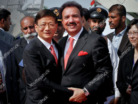 Pakistani Interior Minister Rehman Malik, center right, greets to Chinese Public Security Minister Meng Jianzhu, center left, upon his arrival at Chaklala airbase in Rawalpindi, Pakistan on . China's top security official is visiting Pakistan for talks focusing on increased cooperation against Chinese militants who are thought to have found sanctuary in the northwest of the country