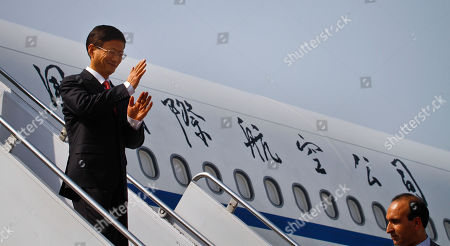 Chinese Public Security Minister Meng Jianzhu waves as he alights from plane upon his arrival at Chaklala airbase in Rawalpindi, Pakistan, on . China's top security official is visiting Pakistan for talks focusing on increased cooperation against Chinese militants who are thought to have found sanctuary in the northwest of the country