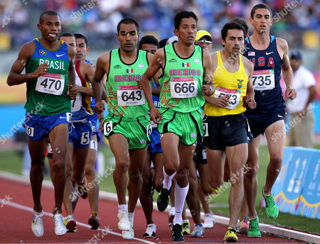Athletes, from left to right, front, Brazil's Joilson Silva, Mexico's Juan Luis Barrios, Mexico's Juan Romero, Ecuador's Byron Piedra and Stephen Furst, of the United States, compete during the men's 5,000m at the Pan American Games in Guadalajara, Mexico, . Barrios won the gold medal, Piedra won the silver medal and Silva won the bronze medal