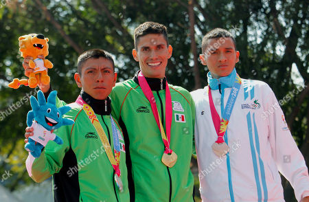 Mexico's Horacio Nava, gold medal, center, Mexico's Jose Ojeda, silver medal, left, and Guatemala's Javier Quiyuch, bronze medal, pose during the award ceremony for the men's 50km walk at the Pan American Games in Guadalajara, Mexico