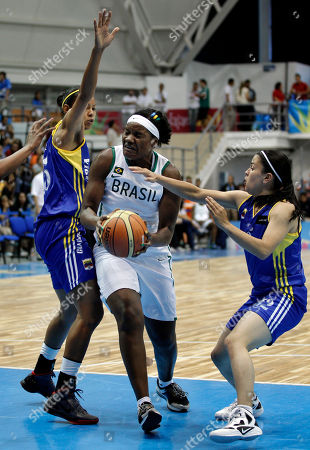Stock Photo of Brazil's Silvia Valente, center, drives the ball next to Colombia's Elena Diaz, left, and Sara Olarte during a women's basketball match for the bronze medal at the Pan American Games in Guadalajara, Mexico