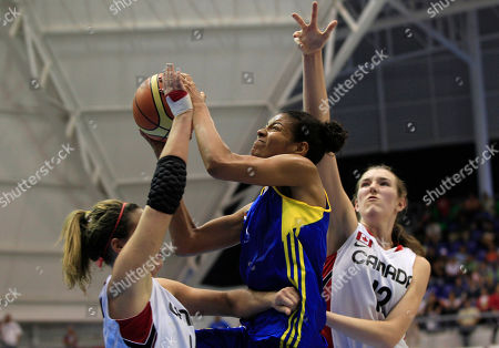 Stock Picture of Colombia's Elena Diaz, center, goes to the basket over Canada's Lindsay Ledingham, left, and Emma Wolfram during the Pan American Games in Guadalajara, Mexico