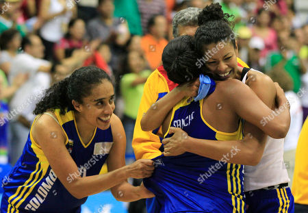 Colombia's Elena Diaz, right, Leidy Sanchez, center, and Mabel Martinez, left, celebrate defeating Canada in a women's basketball game at the Pan American Games in Guadalajara, Mexico