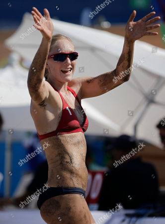Emily Day of the United States celebrates her and her teammate's win in the women's beach volleyball quarterfinal match against Uruguay at the Pan American Games in Puerto Vallarta, Mexico, . United States won 2-0