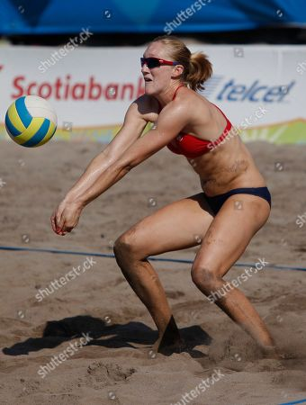 Emily Day of the United States, right, in action during a women's beach volleyball quarterfinal match against Uruguay at the Pan American Games in Puerto Vallarta, Mexico, . United States won 2-0