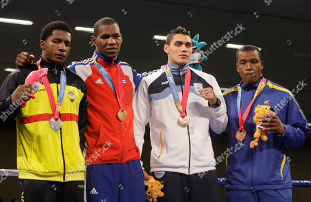 Gold medalist Lenier Pero of Cuba, center left, silver medalist Julio Castillo of Ecuador, left, bronze medal winners Anderson Emmanuel of Barbados, right, and Yamil Peralta of Argentina pose in the podium of the men's 91kg of the boxing competition at the Pan American Games in Guadalajara, Mexico