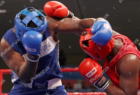 Colombia's Isaia Mena, right, fights Danny Kelly, from the United States during a men's boxing +91kg super heavy quarterfinals at the Pan American Games in Guadalajara, Mexico