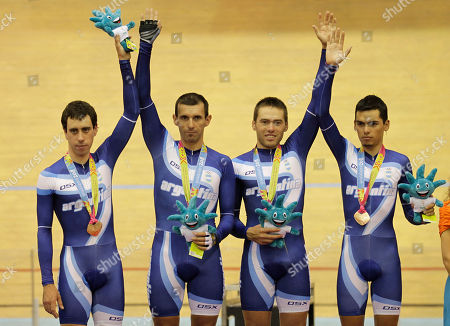 From left: Argentina's team Eduardo Sepulveda, Walter Perez, Marcos Crespo and Maximiliano Almada celebrate after winning the bronze medal at the cycling men's pursuit event of the Pan American Games in Guadalajara, Mexico