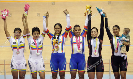 From left: Colombia's Juliana Gaviria, Diana Garcia, silver medal, Venezuela's Mariestela Vilera and Daniela Larreal, gold medal, and Mexico's Luz Gaxiola and Nancy Contreras, bronze medal, celebrate in the podium during the cycling women's pursuit award ceremony at the Pan American Games in Guadalajara, Mexico