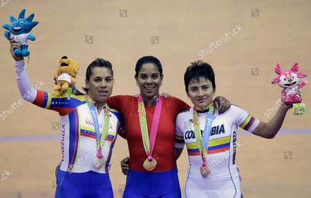 Cuba's Lisandra Guerra, center, Venezuela's Daniela Larreal, left and Colombia's Diana Garcia, pose for pictures after winning gold, silver and bronze medals respectively in cycling women's speed final at Pan American Games in Guadalajara, Mexico