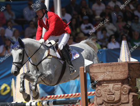 Michael Pollard of the United States takes Schoensgreen Hanni over a jump in the equestrian eventing team jump at the Pan American Games in Guadalajara, Mexico
