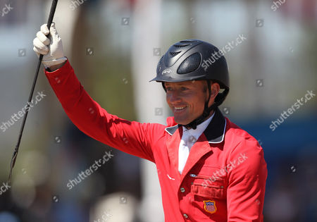 Stock Picture of Michael Pollard of the United States celebrates his team's gold medal win in the equestrian eventing team jump competition at the Pan American Games in Guadalajara, Mexico