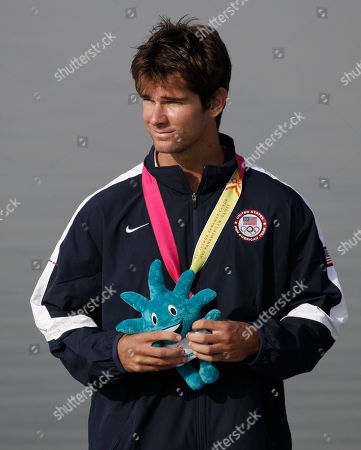 Bronze medal winner Ryan Dolan of the United States stands on the winner's podium during the awards ceremony for the men's K1 200m kayak event at the Pan American Games in Ciudad Guzman, Mexico